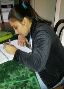 Tania studying for her first university exams