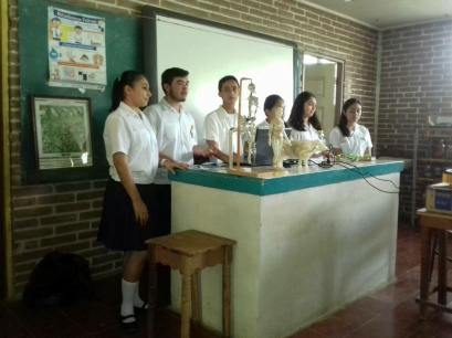 Tania and some of her classmates giving a science presentation