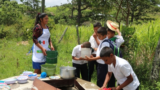 Washing the dishes in the community well